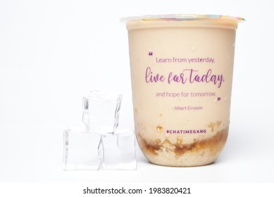 'Kuala Lumpur, Malaysia- Circa May, 2021: A picture of Chatime boba tea container written Albert Einstein quote and ice cube insight. Learn from yesterday, live for today and hope for tomorrow