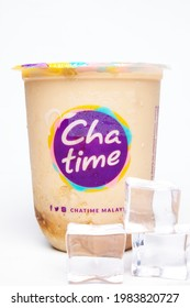 """""""Kuala Lumpur, Malaysia- Circa May, 2021: A picture of Chatime water container with brown sugar tea with oat and ice cube insight."""""""