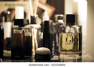 "Kuala Lumpur, Malaysia - Circa September 2019: designer perfurm ""Acqua Di Gio Absolu"" by Giorgio Armani on a make up table. On background, several other out of focus perfume brand. Selective focus"