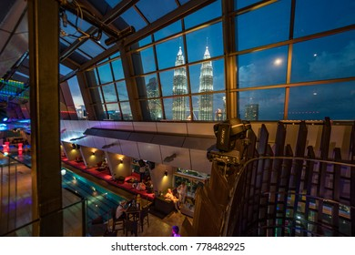 Kuala Lumpur, MALAYSIA - circa September 2015: Great ambiance at the Skybar on Level 33, Traders Hotel in Kuala Lumpur during blue hour sunset. Soft focus due to handheld.