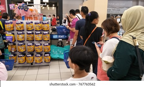 KUALA LUMPUR, MALAYSIA- DEC 1 2017: Crowd of people queing at cashier counter in Tesco Extra Cheras, Kuala Lumpur during Year End Sale and Back To School campaign.