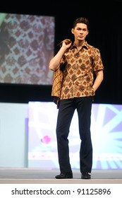 KUALA LUMPUR, MALAYSIA - DEC 10: A model displays creation by Asmoro Damais from Indonesia during Kuala Lumpur International Batik (KLIB2011) fashion show on December 10, 2011 in Kuala Lumpur, Malaysia
