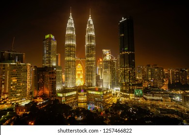 Kuala Lumpur, Malaysia – Dec 12 2018 : Petronas Twin Towers (fondly known as KLCC) and the surrounding buildings at night seen from the Skybar at Traders Hotel.