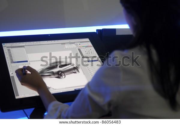KUALA LUMPUR, MALAYSIA - DEC 3: An unidentified artist showcases a digital sketching of a concept car during Kuala Lumpur International Motor Show on December 8, 2010 in Kuala Lumpur Malaysia.