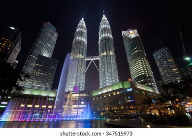 Kuala Lumpur, Malaysia - DECEMBER 02 2015: The Petronas twin towers shine at night with fountain show in the Kuala Lumpur City Center (KLCC). The image was taken a month before the Christmas Day.