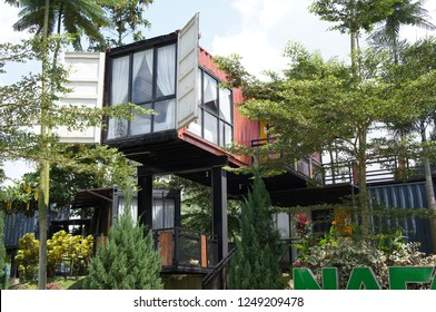 KUALA LUMPUR, MALAYSIA -DECEMBER 03, 2018: Residential house made from refurbish shipping container. Surrounded with beautiful landscape.