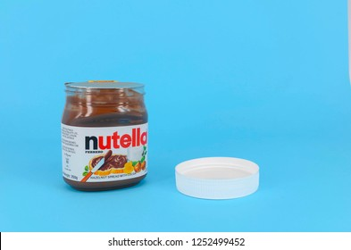 Kuala Lumpur, Malaysia - December 08, 2018; Closeup Nutella on blue background. Nutella is widely popular brand name of a sweetened hazelnut cocoa spread. Selective focus.