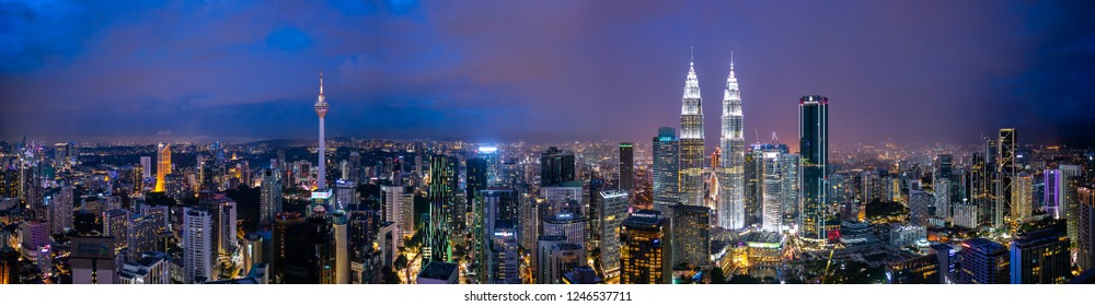 Kuala Lumpur, Malaysia - December 1, 28, 2018: Panorama shot of sunset at Kuala Lumpur city skyline with Petronas KLCC Twin Towers, KL Tower and surrounding building.