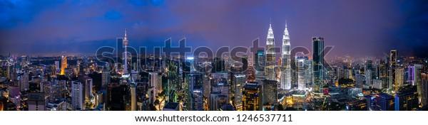 Kuala Lumpur, Malaysia - December 1, 28, 2018: Panorama shot of sunset at Kuala Lumpur city skyline with Petronas KLCC Twin Towers, KL Tower and surrounding building.