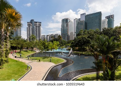 KUALA LUMPUR, MALAYSIA, December 13, 2017: KLCC Park is a public park in Kuala Lumpur, Malaysia. Wading pool is in the middle of the park.