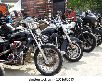 KUALA LUMPUR, MALAYSIA -DECEMBER 16, 2017: Various model of custom Harley Davidson easy rider motorcycle parking in the open area during its owners gathering in Kuala Lumpur, Malaysia.