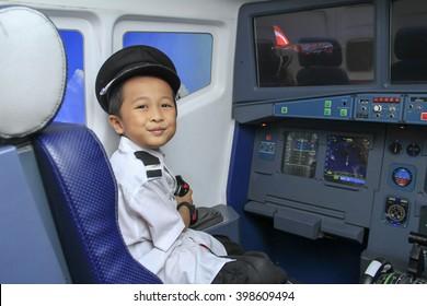 KUALA LUMPUR, MALAYSIA - DECEMBER 16: Kidzania - one boy seat cockpit environment   inside kidzania   on December 16, 2014 in Kuala Lumpur