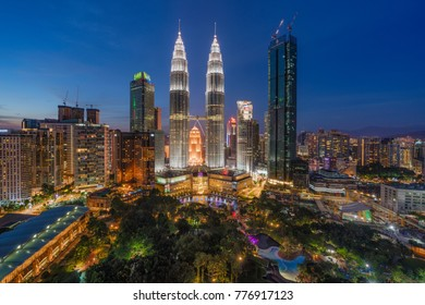 Kuala Lumpur, MALAYSIA - December 17, 2017: Evening view of the Petronas Twin Towers and Kuala Lumpur skyline taken from the Skybar of Traders Hotel. This is processed beautifully in HDR.