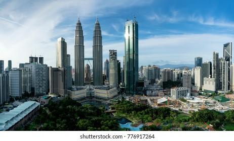 Kuala Lumpur, MALAYSIA - December 17, 2017: Evening view of the Petronas Twin Towers and Kuala Lumpur skyline taken from the Skybar, Traders Hotel.