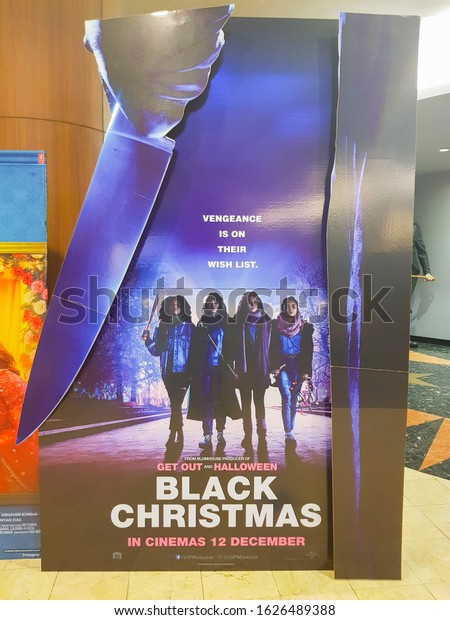 KUALA LUMPUR, MALAYSIA - DECEMBER 18, 2019: Black Christmas movie standee, is a 2019 American slasher film starring Imogen Poots, Aleyse Shannon, Lily Donoghue and Brittany O'Grady