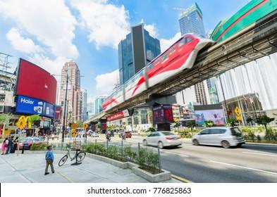 Kuala Lumpur, Malaysia - December 18,2017 : KL Monorail train public transport passing through Bukit Bintang area. People can seen exploring around it.