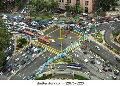 Kuala Lumpur, Malaysia, December 19, 2018: Aerial view looking down onto very busy intersection with heavy traffic, in Kuala Lumpur, capital city of Malaysia