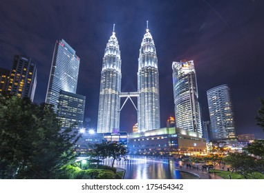 KUALA LUMPUR, MALAYSIA - DECEMBER 19: Night time of Petronas Twin Towers on December 19, 2013 in Kuala Lumpur, Malaysia. This building (451.9m/88 floors) is the tallest twin buildings in the world