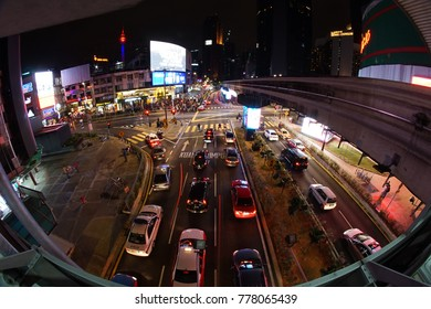 KUALA LUMPUR, MALAYSIA - December, 19 2017: Night view of busy traffic on Jalan Bukit Bintang and from there can see the beautiful KL Tower in Kuala Lumpur Malaysia.