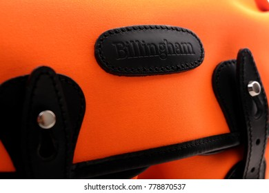 Kuala Lumpur, Malaysia - December 20, 2017: Close up of Billingham Hadley Small shoulder bag in Neon Orange with black Leather trim. Billingham bags is a British brand of professional camera bag.