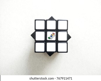 Kuala Lumpur , Malaysia - December 2017 : Rubik's cube with shadow on white floor background. Rubik's cube invented by a Hungarian architect Erno Rubik in 1974.