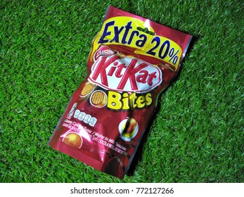 KUALA LUMPUR, MALAYSIA - DECEMBER, 2017 : Kit Kat Bites pack is on the grass background.Kit Kat is manufactured and sold under licence from Nestlé in the United States by Hershey.