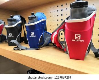 Kuala Lumpur, Malaysia - December 2018 : Salomon water bottles at Mitsui outlet store. SALOMON International. Sporting goods for men, women and children.