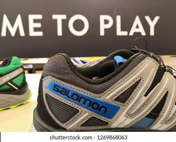 Kuala Lumpur, Malaysia - December 2018 : Salomon shoes display for sale at Mitsui outlet store. Selective focus. SALOMON International: Selective focus. Sporting goods for men, women and children.