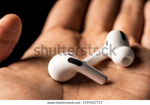 Kuala Lumpur, Malaysia - December 2019. Apple Airpods Pro isolated against black. The new airpods pro features active noise cancelling and  customizable fit