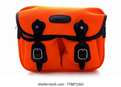 Kuala Lumpur, Malaysia - December 21, 2017: BILLINGHAM HADLEY SMALL bag in Neon Orange with black Leather trim on white background. Billingham bags is a British brand of professional camera bag.