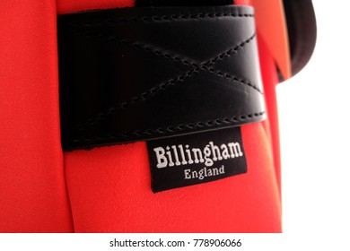 Kuala Lumpur, Malaysia - December 21, 2017: Close up of Billingham camera bag brand in Neon red with black Leather trim. Billingham bags is a British brand of professional camera bags