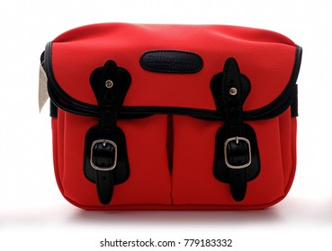 Kuala Lumpur, Malaysia - December 21, 2017: BILLINGHAM HADLEY SMALL bag in Neon red with black Leather trim on white background. Billingham bags is a British brand of professional camera bag