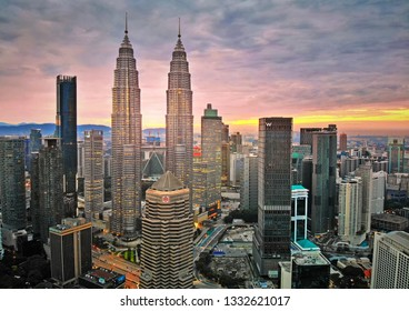 KUALA LUMPUR, MALAYSIA - DECEMBER 21st, 2018 : Majestic view of Petronas Twin Towers with beautiful sunset background. Petronas Twin Towers also known as KLCC is the tallest building in Malaysia