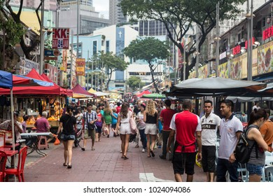 Kuala Lumpur, Malaysia - December 22 2017: Tourists and locals wander along Jalan Alor famous for its chinese food restaurant and street food stalls near Bukit Bintang in Kuala Lumpur.