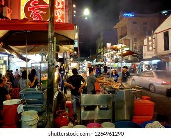 Kuala Lumpur, Malaysia - December 22 2018: Street food in Kuala Lumpur Chinatown, by the Petaling street market, at night in Malaysia capital city