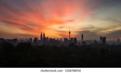 KUALA LUMPUR, MALAYSIA - DECEMBER 22, 2018: Kuala Lumpur city skyline at sunrise with colourful skies.