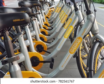 Kuala Lumpur, Malaysia. December 28, 2017. Row of bicycles parked near Ampang Park LRT station. oBike is the first stationless bicycle sharing system offers commuters alternative mode of transport