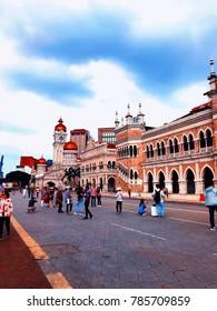 Kuala Lumpur, Malaysia - December 28, 2017: Tourists at Dataran Merdeka or Merdeka Square Kuala Lumpur's best known landmark.