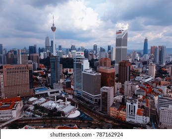 Kuala Lumpur, Malaysia - December 28, 2017: Aerial view of Kuala Lumpur City skyline taken on cloudy day. In this picture there are few landmarks building such as KL Tower, Petronas Twin Tower and etc
