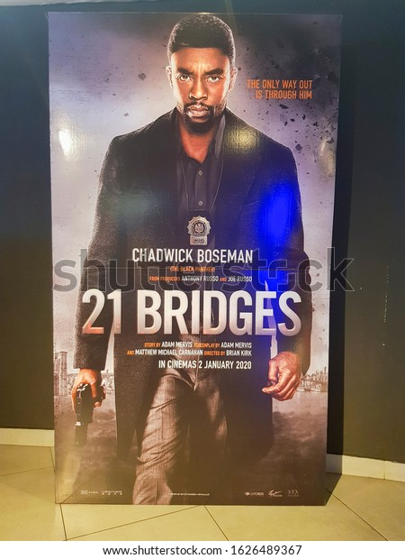 KUALA LUMPUR, MALAYSIA - DECEMBER 31, 2019: 21 Bridges movie standee, is a 2019 American action thriller film directed by Brian Kirk.