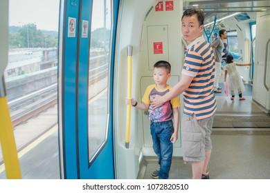KUALA LUMPUR, MALAYSIA - December 31th,  2017: Passengers inside Mass Rapid Transit MRT train . MRT is Mass Rapid Transit Corporation Sdn Bhd, in Kuala Lumpur, M`alaysia.