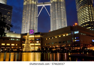KUALA LUMPUR, MALAYSIA - DECEMBER 4: Night scene of Petronas Twin towers Suria KLCC colorful dancing fountain with music with Christmas tree at the back in Kuala Lumpur, Malaysia on December 4, 2015