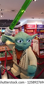 Kuala Lumpur / Malaysia - December 5 2018: Lego Yoda holding a light saber displayed in a toy store, KLIA airport