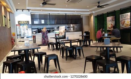 KUALA LUMPUR MALAYSIA - December 5, 2018: Unidentified people dine at food court Suria KLCC Shopping mall in Kuala Lumpur, Malaysia