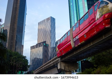 KUALA LUMPUR, MALAYSIA - DECEMBER 5, 2019: Equatorial Plaza with Monorail Car Passing in the Foreground