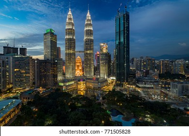 KUALA LUMPUR, MALAYSIA - DECEMBER 6, 2017: Beautiful view of Petronas Twin Towers (fondly known as KLCC) and the surrounding buildings at sunset seen from the Skybar at Traders Hotel.