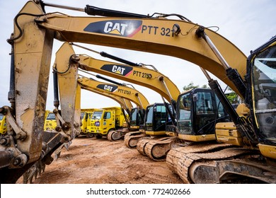 Kuala Lumpur, Malaysia - December 9, 2017: Modern hydraulic excavator on a field work site where an excavation works is performed in Kuala Lumpur, Malaysia.