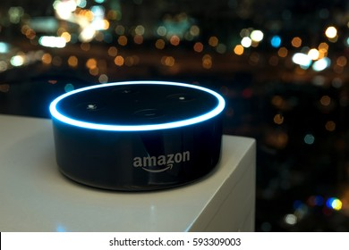 Kuala Lumpur, Malaysia - Fabruary 24 : Selective focus on Amazon Echo dot version 2, the voice recognition streaming device from Amazon on table. February 24 2017 in Kuala Lumpur, Malaysia