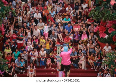 KUALA LUMPUR, MALAYSIA - FEB 21, 2016: Big head buddha teasing the crowd with gifts during auspicious monkey year of Chinese New Year festival at Pavillion shopping gallery, Kuala Lumpur Malaysia.