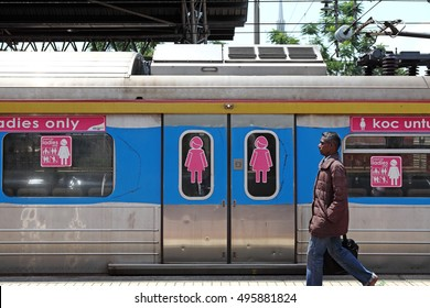 KUALA LUMPUR, MALAYSIA - FEB 23, 2014: A man walk pass a ladies only coach in the Kuala Lumpur Railway Station in Jln Sultan Hishamuddin. The coach was introdued in 2010 to prevent sexual harassment.